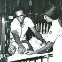Image of Dr Walter Tasem, Pediatrician, and Carole King with a pediatric patient.