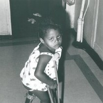 Image of Young child with crutches.
