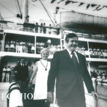 Image of Dr and Mrs William B Walsh walking down gangway on arrival in Maceio.