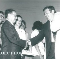Image of Dr William B Walsh shaking hands.