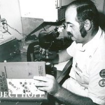 Image of Jerry Smith, Cytologist, working at the microscope.