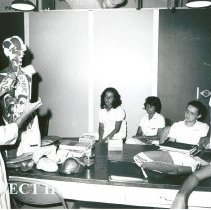 Image of Marie Storaasli, Medical Technologist, conducting a seminar for counterpart