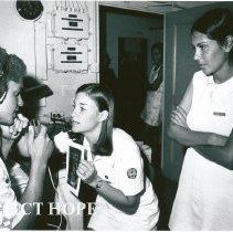 Image of Gwen Orr, Audiologist, with counterpart and patient in the Audiologist Dept
