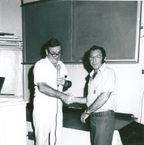 Image of Dr William B William and Arnie Cohen, Medical Stores receiving an award.