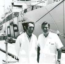 Image of Dr William B Walsh and Dennis Lucey, Administrator, in front of the SS HOPE