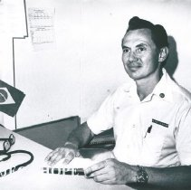 Image of Dr Martin Shearn sitting at a desk.