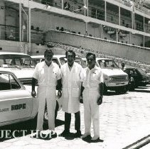 Image of Dr William B Walsh, Dennis Lucey and Dr Martin Shearn in front of SS HOPE