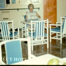 Image of Boat deck lounge, Mrs. Tompkins sewing.