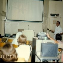 Image of Ron Neafie, Parasitologist giving a lecture.