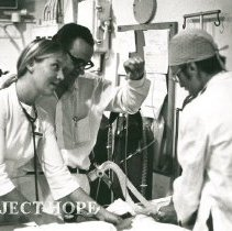 Image of Gail Goodrich with counterpart on SS HOPE