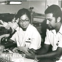 Image of Linda Nims, Medical Technologist, with counterpart in laboratory