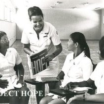 Image of MacGillis, Ann, nurse educator, with students