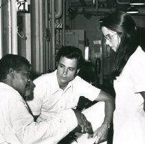 Image of unknown Dr and unknown nurse with patient