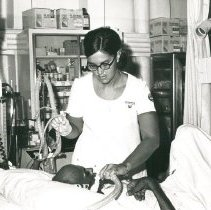 Image of Donna Westmoreland, nurse, with patient