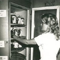 Image of Andrea Stevens, Med Tech, inspecting blood in the Blood Bank refrigerator