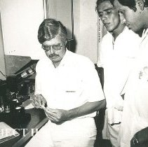 Image of Dr Frank Evans, Dentist, with Dental students