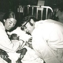 Image of Dr Duke Duncan, Pediatrician, and Sue Rechner, Pediatric nurse, with infant