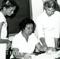 Image of Barerras, June, Project HOPE nurse with counterparts in Maceio clinic