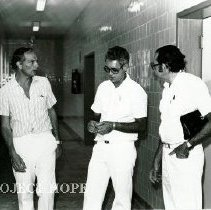 Image of Bob Petit, hospital administrator, on right with counterparts