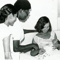 Image of Agatha Lowe, Project HOPE nurse in the middle with counterpart and patient