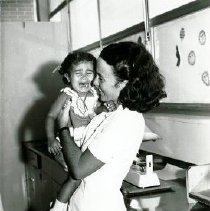 Image of Nurse Christine O'Grady with patient in Maceio clinic