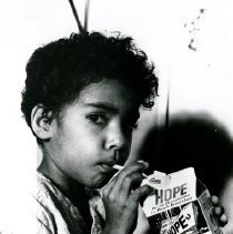 Image of Child drinking milk from the SS HOPE