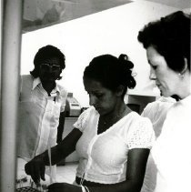 Image of Mary Lou Ahearn, Medical Technologist, with counterpart in lab