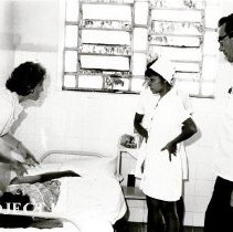 Image of Kay Burwell, Pediatric nurse, and Dr Harold Royaltey with counterpart