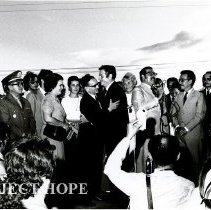 Image of William B. Walsh recieves a welcoming hug from Governor of Alagoas, Lopes