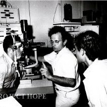 Image of Dr. Sheldon Kaplan explains examination procedures to Brazilian counterpt