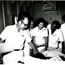 Image of HOPE general surgeon Robert G. Wochos, MD, and his counterparts.