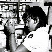 Image of Medical-surgical nurse Lynn Kracker prepares an injection syringe.