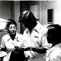 Image of Dr. William Elkins, volunteer for 2 months, shares dental skills with count