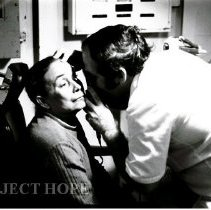 Image of Ophthalmology resident Michael A. Golden, MD, examines patient.
