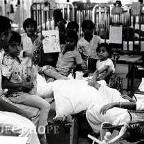 Image of Dr. Walsh with patients in the Pediatric Ward on SS HOPE.