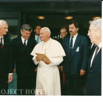 Image of Pope John Paul II and Dr. Walsh far right
