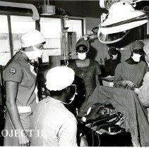 Image of Margot Barrett observes techniques of nurse anesthetist at major operation