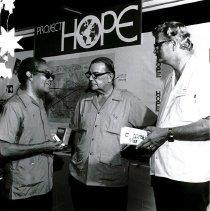 Image of Dr. Wells, Mr. C. Burton, John Schaaf at Barbados' first Health Exhibition
