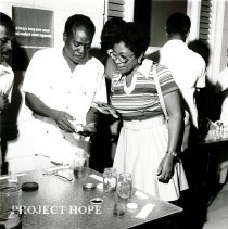 Image of Public Health Inspector with Parliamentary Secretary at workshop