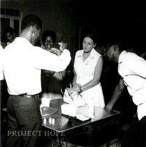 Image of PHI student demonstrating test for presence of chlorine
