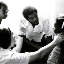 Image of Dr Martin Debeukelaer, Pediatrician, at UHWI Clinic with counterparts.