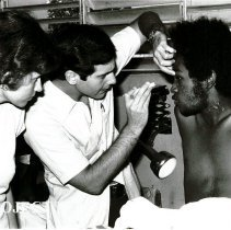 Image of Dr Myles Kreiger exames Jamaican patient while Regina Kreiger looks on.