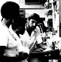 Image of George Strein, Pharmacist, with student interns.