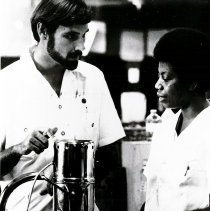 Image of George Strein, Pharamist, with pharmacy interns.