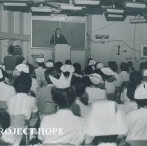 Image of Dr Walsh addressing a class aboard the SS HOPE on Voyage I.