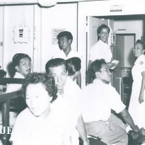 Image of Ann MacGregor with patients awaiting admission on the SS HOPE on  Voyage I.
