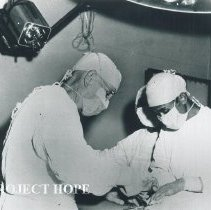 Image of Voyage I a SS HOPE surgeon operating with a local countrerpart assisting.
