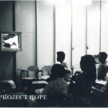 Image of Indonesian doctors and nurses watching operation via TV. Voyage I 1960