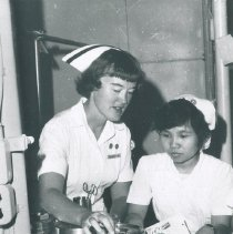 Image of A nurse and counterpart on the SS HOPE teaching sterilization on Voyage I.