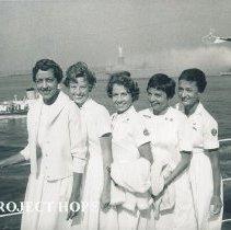 Image of Nurses Ann MacGregor, ??, Dorothy Aeschliman, ? arriving home from Ecuador.